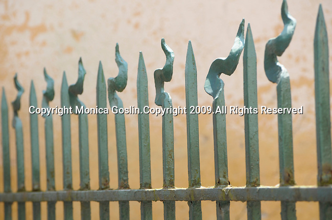 Detail of a green iron fence in the town of Cremeno, a town in the mountains of Lake Como, Italy.