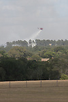 An aerial fire fighting helicopter drops water on the Dyer Mill fire on Monday June 20, 2011 in Grimes County, Texas east of Whitehall.