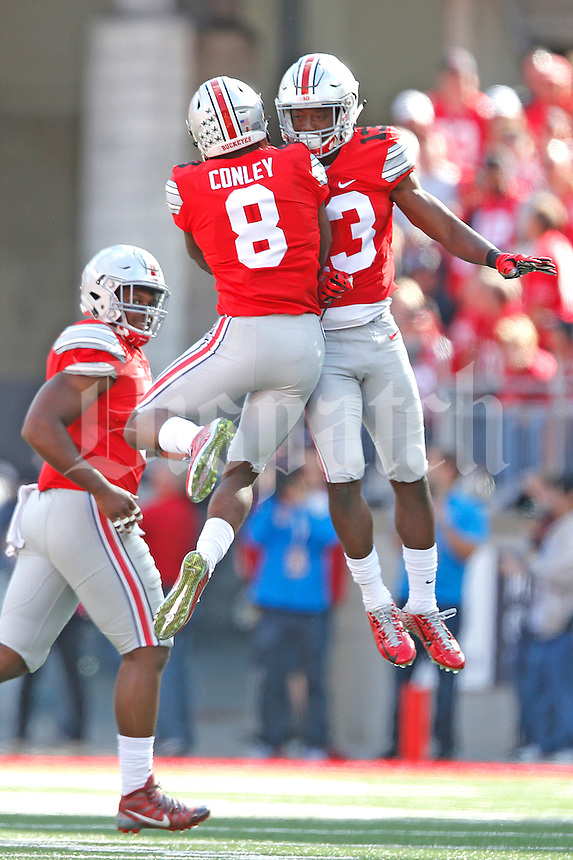 Ohio State Buckeyes cornerback Gareon Conley (8) celebrates his interception with Ohio State Buckeyes cornerback Eli Apple (13) in the second quarter at Ohio Stadium on September 12, 2015. (Chris Russell/Dispatch Photo)