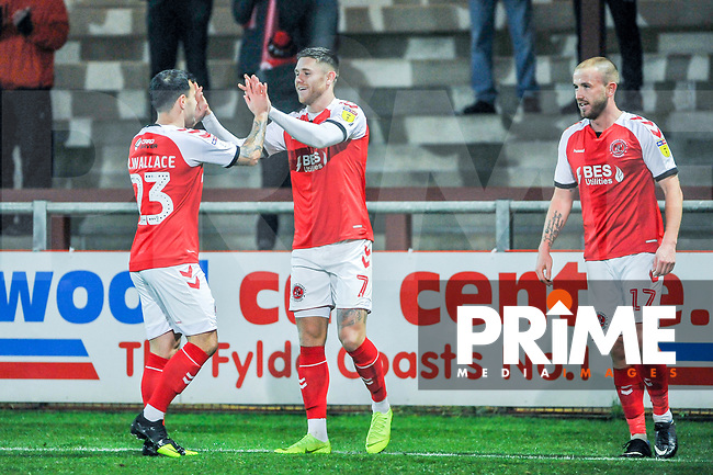 Fleetwood Town's midfielder Ross Wallace (23) congratulates Fleetwood Town's forward Wes Burns (7) during the Sky Bet League 1 match between Fleetwood Town and Coventry City at Highbury Stadium, Fleetwood, England on 27 November 2018. Photo by Stephen Buckley / PRiME Media Images.