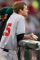 Kyle Russell #25 of the Great Lakes Loons watches the action from the dugout as his team bats versus the Dayton Dragons at Fifth Third Field April 22, 2009 in Dayton, Ohio. (Photo by Brian Westerholt / Four Seam Images)
