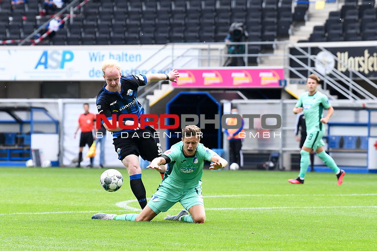 Ben Zolinski (SC Paderborn #31) foult Christoph Baumgartner (TSG 1899 #14)<br /><br />Foto: Edith Geuppert/GES /Pool / Rauch / nordphoto <br /><br />DFL regulations prohibit any use of photographs as image sequences and/or quasi-video.<br /><br />Editorial use only!<br /><br />National and international news-agencies out.