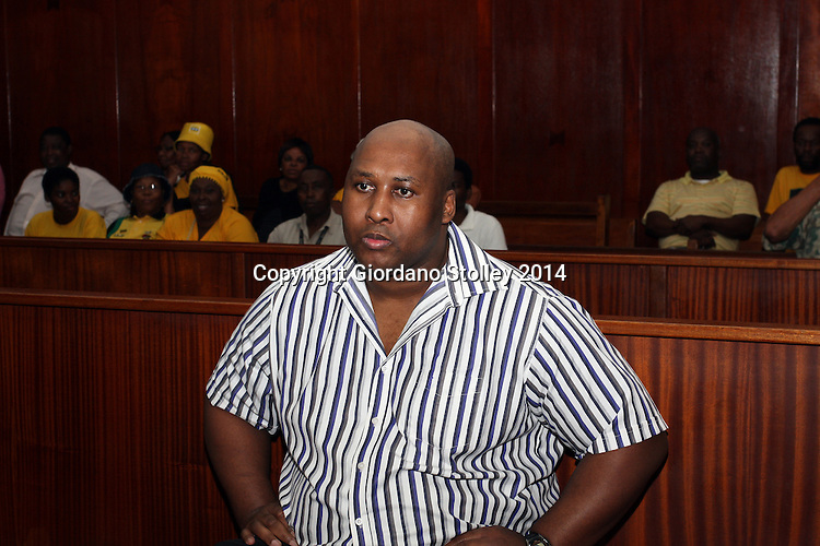 DURBAN - 24 September 2014, Former Blue Bulls rugby player Phindile Joseph Ntshongwana who stands accused of killing four people with an axe, trying to kill two others, raping another and assaulting  another person sits in the dock in the Durban High Court before Acting Judge Irfaan Khalil started delivering his judgement. Picture: Allied Picture Press/APP