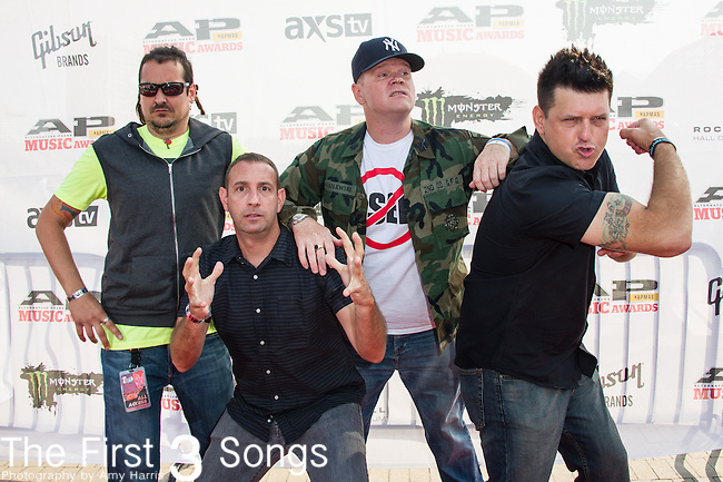 "Chris Demakes, Roger Lima, Vinnie Fiorello, Buddy Schaub, and Peter ""JR"" Wasilewski of Less Than Jake attends the 2014 AP Music Awards at the Rock And Roll Hall Of Fame and Museum at North Coast Harbor in Cleveland, Ohio."