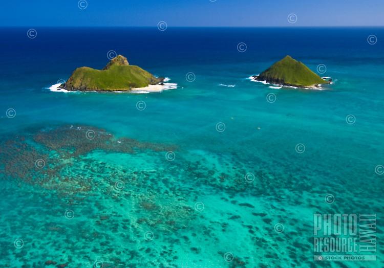 Aerial of the Moku Lua islands of the coast of Lanikai, Kailua, windward Oahu