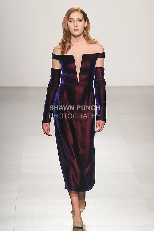 Model walks runway in an outfit from the Irina Vitjaz Fall Winter 2017 collection, at Skylight Clarkson Square on February 15, 2017; during NYFW: The Shows Fall Winter 2017.