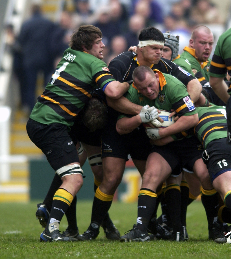 .Photo. Jed Wee.Newcastle Falcons v Northampton, Zurich Premiership, Kingston Park, Newcastle. 20/04/2003..Northampton's Steve Thompson (in possession) with Newcastle's Marius Hurter.