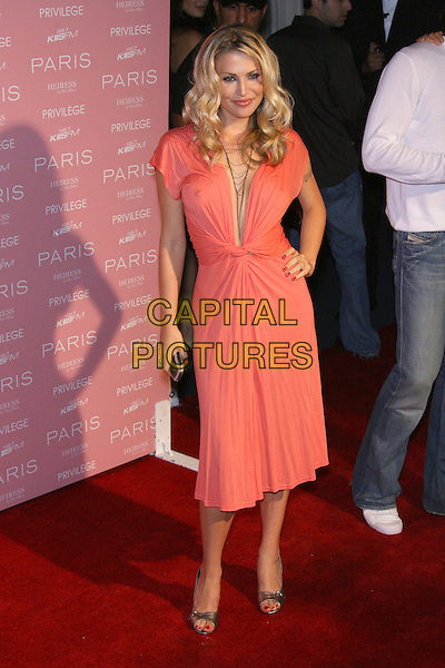 WILLA FORD.Paris Hilton's CD Release Party - Arrivals held at Privilege, West Hollywood, California, USA..August 18th, 2006.Ref: ADM/ZL.half length hand on hip pink peach dress plunging neckline.www.capitalpictures.com.sales@capitalpictures.com.©Zach Lipp/AdMedia/Capital Pictures.