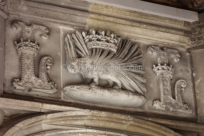 Relief of a porcupine with crown and initial L, symbol of Louis XII, on the secondary staircase of the North facade, between the Louis XII wing and the Grande Salle des Etats Generaux, at the Chateau Royal de Blois, built 13th - 17th century in Blois in the Loire Valley, Loir-et-Cher, Centre, France. The chateau has 564 rooms and 75 staircases and is listed as a historic monument and UNESCO World Heritage Site. Picture by Manuel Cohen