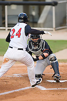 Delmarva Shorebirds catcher Brendan Monaghan (15) blocks the plate as Christian Marrero (24) of the Kannapolis Intimidators tries to score at Fieldcrest Cannon Stadium in Kannapolis, NC, Wednesday, May 14, 2008.