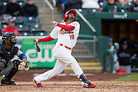 Ruben Gotay #18 of the Springfield Cardinals follows through his swing after making contact on a pitch during a game against the Tulsa Drillers at Hammons Field on May 4, 2013 in Springfield, Missouri. (David Welker/Four Seam Images)