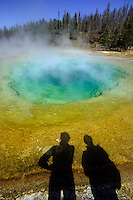Morning Glory Pool in Yellowstone with the shadow of two tourists watching it foto, reise, photograph, image, images, photo,<br /> photos, photography, picture, pictures, urlaub, viaje, vacation, imagen, viagi, stock