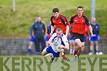 Gary Sayers of Keel is tackled by Tarbert's Ian Flavin and Shane Enright last Sunday afternoon in Shannon Park, Tarbert.