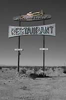 Located on Historic Route 66 in the Mojave Desert east of Amboy, California, the remains of the Roadrunner's Retreat slowly succumbs to the desert. The stop would have been a welcome sight to auto travelers driving through the hot desert during the summertime.