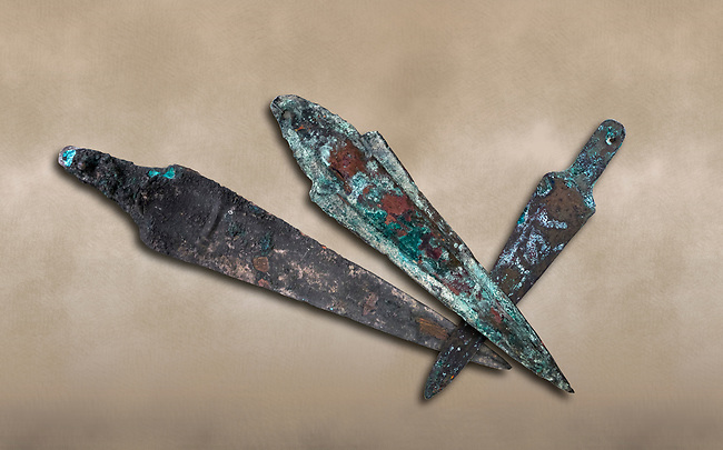 Hittite bronze spear heads. Hittite Period 1650 - 1450 BC.  Hattusa Boğazkale. Çorum Archaeological Museum, Corum, Turkey. Against a warm art bacground.