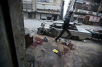 In this Monday, Dec. 03, 2012 photo, a Syrian resident runs for cover during heavy shelling in Bustan Al-Pasha district in Aleppo, the Syrian's largest city. (AP Photo/Narciso Contreras)