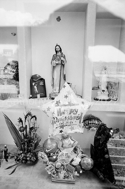 Culiacan, Sinaloa.Mexico.July 4, 2008..Humaya?s cemetery monuments are elaborate tombs for the drug traffickers and are constantly being added. New empty expanding graves are set in long rows. Certain tombs contain images of drug traffickers banishing their automatic weapons. From January 1 to mid-July 2008 there have been 535 drug related killings in Sinolao, many of them were police officers...