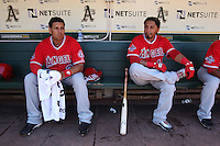 OAKLAND, CA - JUNE 10:  Juan Rivera #20 and Maicer Izturis #13 of the Los Angeles Angels of Anaheim get ready in the dugout before the game against the Oakland Athletics at the Oakland-Alameda County Coliseum on June 10, 2010 in Oakland, California. Photo by Brad Mangin