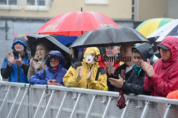 The audience braves the weather in Abbey Street Car Park during Fleadh Cheoil na hEireann in Ennis. Photograph by John Kelly.