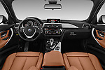 Stock photo of straight dashboard view of 2016 BMW 3-Series 328i-xDrive-Sports-Wagon 5 Door Wagon Dashboard