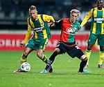 Nederland, Nijmegen, 5 oktober 2012.Eredivisie.Seizoen 2012-2013.N.E.C.-ADO Den Haag.Kevin Visser (l.) van ADO Den Haag en Soren Rieks (r.) van N.E.C. strijden om de bal.