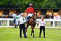 Pow Wow ridden by Kieran Shoemark is led into the winners enclosure after winning The Derek Burridge Golf & Racing Trophies Handicap, during Father's Day Racing at Salisbury Racecourse on 18th June 2017