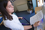 Young woman with walking frame doing some photocopying in an office. MR