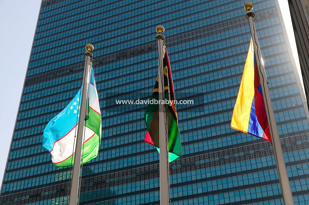 8 September 2005 - New York City, NY - Member state flags fly in front of the Secretariat building at the United Nations headquarters in New York, USA, 8 September 2005, for the first time since early this year. Construction work prevented the flags from being hoisted. The 4 by 6 feet flags are placed in English alphabetical order, from Afghanistan, at 48th Street, to Zimbabwe, by 42nd Street. They come down every day at 4pm and are stored in small boxes at the base of the poles. Photo Credit: David Brabyn