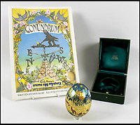 BNPS.co.uk (01202 558833)<br /> Pic: Batemans/BNPS<br /> <br /> A couple are celebrating a nice little nest egg for their retirement after their one-of-a-kind 22ct gold egg made by Cadbury's sold for &pound;20,000.<br /> <br /> The chocolate company commissioned 12 golden eggs made by the Queen's jeweller for a calamitous competition in 1983 that saw thousands of treasure hunters dig up the countryside.<br /> <br /> Unbeknownst to the public a 13th larger egg was also produced which Cadbury's awarded to one of its retailers as a thank you for helping with the competition.<br /> <br /> This egg has now sold for &pound;20,640, including fees, at Batemans Auctioneers in Stamford, Lincs, and it was bought by one of the original treasure hunters, who has waited 34 years to get their hands on a golden egg.