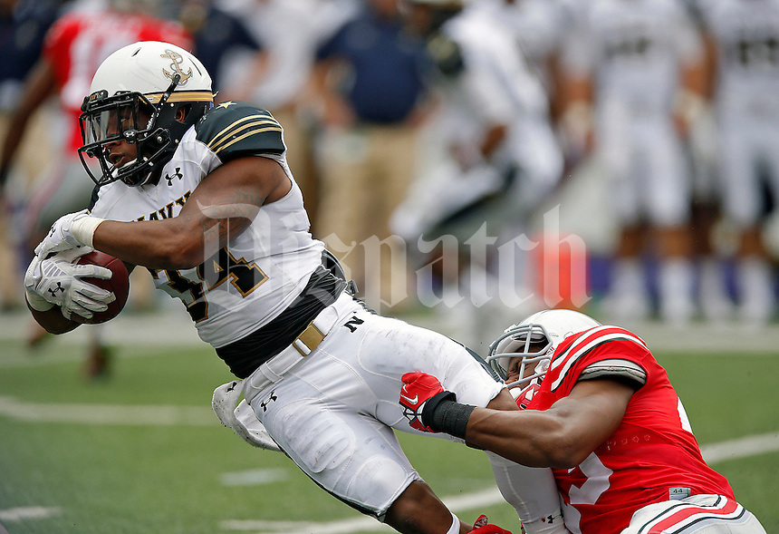 Ohio State Buckeyes linebacker Darron Lee (43) tries to stop Navy Midshipmen fullback Noah Copeland (34) during a run in the 2nd quarter of their NCAA game at M&T Bank Stadium in Baltimore, Maryland on August 30, 2014. (Dispatch photo by Kyle Robertson)