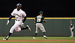 Seattle Mariners' James Jones rounds the bases before sliding head first into third base after hitting  a triple to center field in the third inning September 13, 2014 at Safeco Field in Seattle.The Athletics beat the Mariners 3-2 when Mariners pitcher Fernando Rodney  walked in Coco Crisp in the 10th inning.  ©2014. Jim Bryant Photo. All Rights Reserved.111