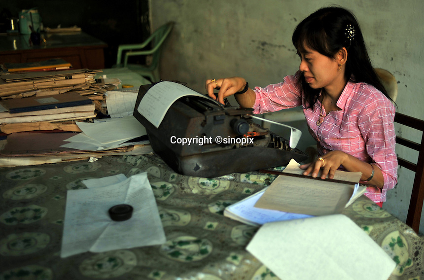 A clerical worker types in the Rangoon police a station, Rangoon, Burma Dec 2008.
