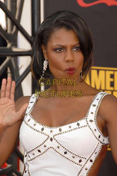 OMAROSA MANIGAULT-STALLWORTH.2007 American Music Awards at the Nokia Theatre LA Live, Los Angeles, California, USA..November 18th, 2007.half length red lipstick white gold studs studded red lipstick hand palm funny face puckering .CAP/ADM/BP.©Byron Purvis/AdMedia/Capital Pictures.