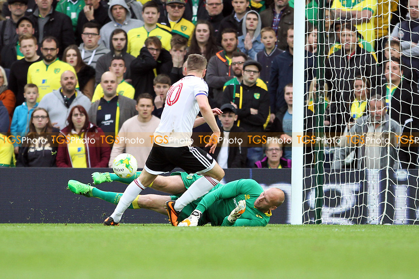 John Ruddy of Norwich City makes a save at the feet of Tom Cairney of Fulham during Norwich City vs Fulham, Sky Bet EFL Championship Football at Carrow Road on 14th April 2017
