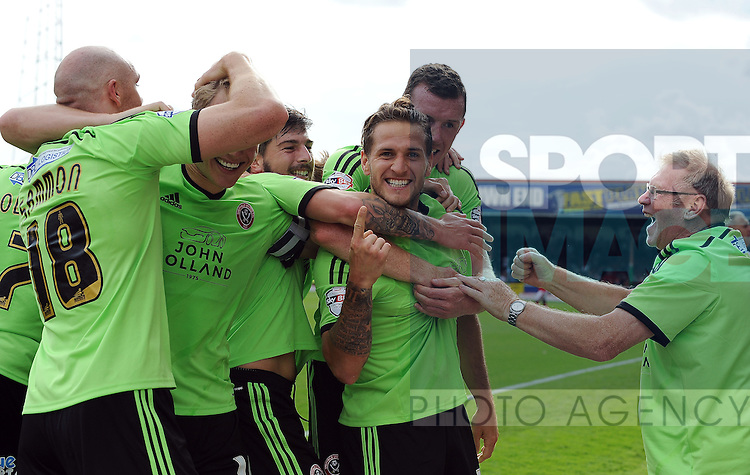 Billy Sharp of Sheffield United celebrates scoring his goal to make it 2-0 with team mates and a disabled sheffield united supporter (right)<br /> - English League One - Swindon Town vs Sheffield Utd - County Ground Stadium - Swindon - England - 29th August 2015<br /> --------------------