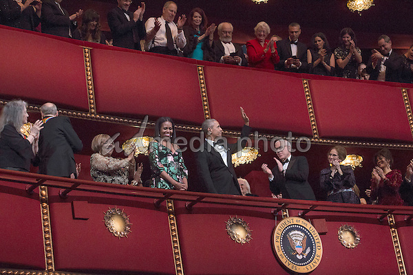 United States President Barack Obama, First Lady Michelle Obama and Kennedy Center Honorees listen to the US National Anthem at the Kennedy Center, December 4, 2016, Washington, DC.  The 2016 honorees are: Argentine pianist Martha Argerich; rock band the Eagles; screen and stage actor Al Pacino; gospel and blues singer Mavis Staples; and musician James Taylor. Photo Credit: Aude Guerrucci/CNP/AdMedia