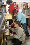 Once the chemistry students have checked their supplies reinstalling their supply drawers can be a little tricky, but help is always nearby. Photo by Robert Jordan/Ole Miss Communications
