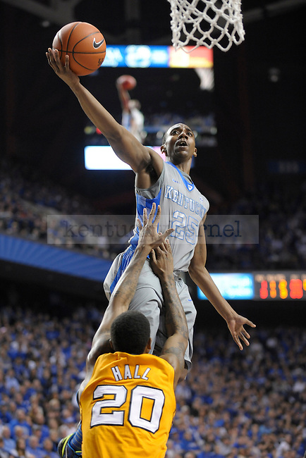 UK's Marquis Teague is fouled by Tennessee defender Kenny Hall during the first half of the University of Kentucky men's basketball game against Tennessee at Rupp Arena in Lexington, Ky., on 1/31/12. UK led the game at halftime. Photo by Mike Weaver | Staff