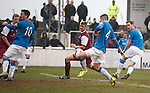 Jon Daly's shot hits off Fraser Aird and into the net for a late winner to Rangers