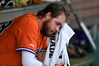 Right fielder Seth Beer (28) of the Clemson Tigers cools off in the dugout in a game against the William and Mary Tribe on February 16, 2018, at Doug Kingsmore Stadium in Clemson, South Carolina. Clemson won, 5-4 in 10 innings. (Tom Priddy/Four Seam Images)