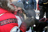 Tuesday March 13, 2007   ----   Lance Mackey, the 2007 Iditarod champion hugs his lead dogs in Nome at the finish line.