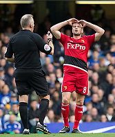 Tom Cleverley of Watford is shocked at a referee decision during the Premier League match between Chelsea and Watford at Stamford Bridge, London, England on 21 October 2017. Photo by Andy Rowland.