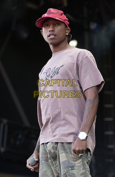 PHARRELL WILLIAMS.Day Two Of The V Festival at Hylands Park, Chelmsford..August 22nd, 2004.half length, stage, singing, concert, gig, t-shirt, tattoos, hat, baseball cap.www.capitalpictures.com.sales@capitalpictures.com.©Capital Pictures
