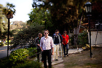 Los Angeles, Calif., April 26, 2009 - From left, Matt Popieluch, Lewis Nicolas Pesacov, Ariel Rechtshaid and Garrett Ray of the band Foreign Born walk along a row of an abandoned homes in Elysian Park in Los Angeles.