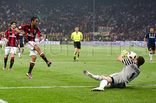 02.04.2011 Alexandre Pato scores two and Antonio Cassano converts a penalty against Inter in what could potentially be a title deciding result. Picture shows Julio Cesar saving a close range shot from Robinho.