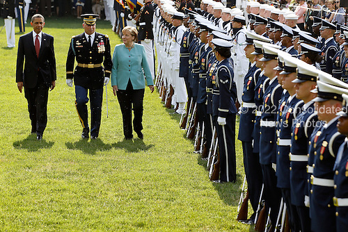 United States President Barack Obama (L) and German Chancellor Angela Merkel (R) review the troops during a welcome ceremony to the White House on the South Lawn June 7, 2011 in Washington, DC. This is the first official visit by a European leader to the White House since Obama became president. Merkel will be presented with the 2010 Medal of Freedom at a state dinner tonight. .Credit: Chip Somodevilla / Pool via CNP