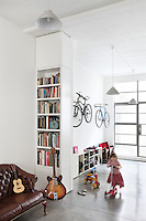 3-year old Chloe scoots at speed across the concrete floor of the open plan living area