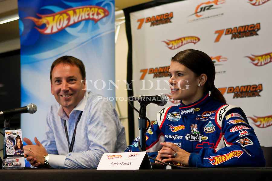 Mattel's VP for Marketing Simon Waldron, left, and Danica Patrick, right, speak at a press conference for the debut of the new Hot Wheels NASCAR sponsored racecar, featuring its iconic red and orange flames, Thursday, Aug. 12, 2010, at Michigan International Speedway in Brooklyn, Mich. Patrick will race in this new Hot Wheels vehicle at this weekend's CARFAX 250 Nationwide race. (Tony Ding/ AP Images for Mattel, Inc.)