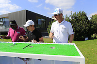 Mikko Ilonen (FIN) and caddy Reggie try the chopsticks challenge during Tuesday's Pro-Am Day of the 2014 BMW Masters held at Lake Malaren, Shanghai, China 28th October 2014.<br /> Picture: Eoin Clarke www.golffile.ie