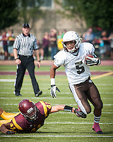 Mt. Carmel defensive back Christian Searles returns a pass interception in the first quarter against loyola Saturday
